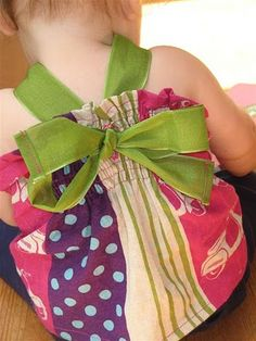 gathered back - ribbon halter gathered thru button hole and tied with a pretty bow