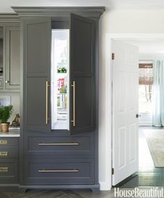 "Freedom Collection refrigerator by Thermador. A cabinetmaker made the beautiful paneling. ""We added a cornice on top and feet on the bottom,..."