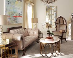 """I love designs that are a little on the eclectic side. So, the """"classic Duncan Phyfe-inspired sofa"""" matched with more modern tables is right up my alley. My favorite in this room is the"""