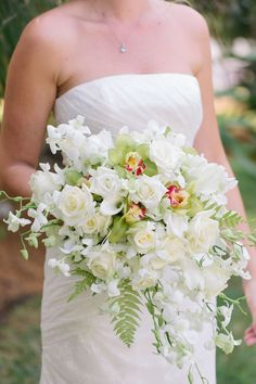 white beach wedding bouquet with orchids and fern by Floral Fantasy, photo by bobcareweddings.com