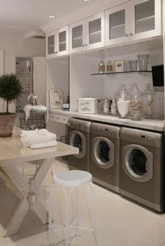 laundry room ideas for design and decoration. Huge laundry room..but I like the apothecary jars filled with clothes pins and laundry room items