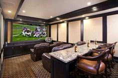 Theater room. I'd rather a comfy sofa and a couple of recliners.. love the idea of a bar in the back