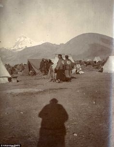 Chinese merchants are seen at the British camp, while the shadow of the photographer looms in the foreground of the picture
