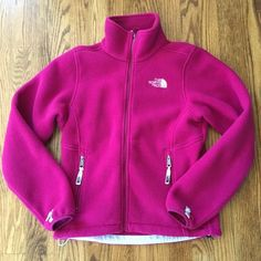 North Face Fuschia Pink Fleece Jacket XS North Face Fuschia Pink Fleece Jacket, Size XS. Adjustable waistband, zippered pockets on each side. Only worn once. No rips, stains, or tears. Happy to answer any questions, post more photos, bundle, and entertain offers. Thanks for looking! North Face Jackets & Coats