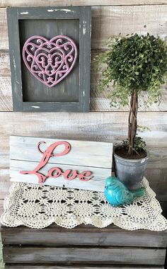 Love this cute & rustic farmhouse style valentine's day decor. wood-look Vday farmhouse stuff can be so cute! simple but shabby & chic! #farmhouse #rustic #vday #valentinesday #decor #afflink