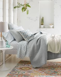 An elevated essential in soft, lightweight cotton, this hand-stitched quilt is an artistic study of texture and simplicity. In a word, it's a dream.