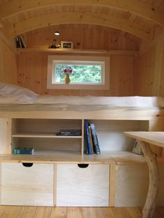 Loft bed in back of bus.