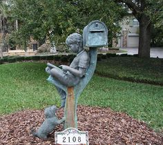 Reading wile leaning on the mailbox