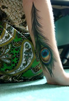 Peacock Feather Tattoo On Arm. The peacock is an emblem of love, compassionate watchfulness, good-will, nurturing, and kind-heartedness.