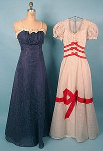 Two summer gowns, c. 1940's. Blue dotted swiss with white trim on left, white and red dotted swiss with red appliqués on right.