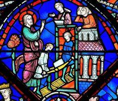 CATHÉDRALE DE CHARTRES VITRAIL DE SAINT THOMAS 1220-1230. «À peine Gundophorus fut-il parti que son architecte se mit à parcourir le pays, distribuant aux pauvres les trésors qui lui avaient été confiés, et élevant des églises.»