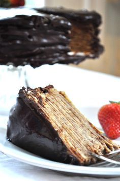 Nutella Crepe Cake with Chocolate Ganache...I just read this blog post and I'm about to go make this....it's 11:47 pm...