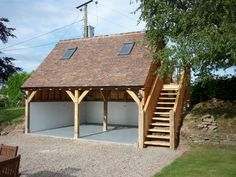 Case study of a bespoke oak framed garage. Two bay lofted garage with with plenty of upstairs storage space by Castle Ring Oak Frame