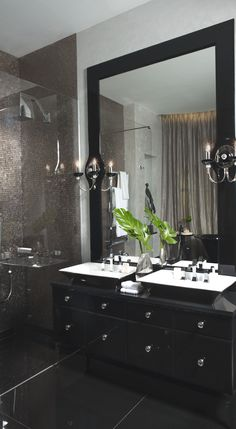 black wood floor and black mirror frame in bathroom.  The question is whether the vanity should be black or white