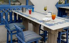 This is a table designed with blue pottery tiles. Interview with Leela Bordia, the Queen of Jaipur Blue Pottery Dinning Table, A Table, Dining Room, Blue Pottery Jaipur, Decorating Blogs, Interior Decorating, Best Interior Design Blogs, Kitchen Stories, Outdoor Furniture Sets