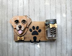 Custom Dog leash holder and treat jar. Cute and practical, this treat/leash holder combination measures approximately 12 long. All the wood is recycled or culled to create a functional piece of art. On the back are two heavy duty key hooks to assure proper hanging with bumpers to