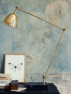 Make a statement out of your lighting with our handsome Brass and Marble Desk Lamp. Each elegant lamp sits on a weighty rectangular black marble base and features a high shine shade on the end of a smooth angled brass stem. With an easily adjustable ar