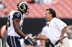 head coach Jeff Fisher shakes hands with St. Louis Rams tight end Jared Cook during warm ups before a game against the Cleveland Browns preseason 2013