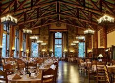 The Ahwahnee Dining Room in Yosemite National Park features sugar pine ceiling trestles and granite pillars.