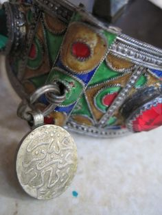 Vintage Moroccan Berber Silver and Enamel Cuff Bracelet with Real Silver Coins Green and Red Glass Beads. $192.00, via Etsy.