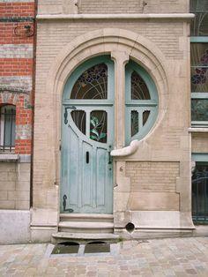 Art Nouveau door at 6 rue du Lac in Brussels by Ernest De Lune