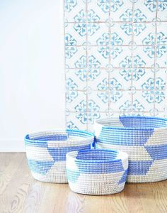 Use these baskets to store clean laundry, balls of yarn, or toys. Hand-woven from cattail stalks and recycled plastic, these baskets will last for years.