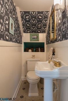 """Tiny powder room under the stairs - """"My Old Country House"""" Blogger's Fixed-Up Farmhouse For Sale - Hooked on Houses"""