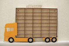 """Купить или заказать Полка """"грузовик"""" для хранения машинок, полочка для моделек, стеллаж в интернет магазине на Ярмарке Мастеров. С доставкой по России и СНГ. Срок изготовления: 3-4 дня. Материалы: фанера. Размер: 458 мм на 324 мм"""