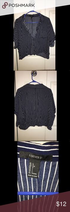 Blue and white striped crop top I bought this shirt a while ago. However, I have not worn it. I don't have anything pair it with so it'd be great if someone else could get a great use out of it ! Could be worn by a small or medium. You could wear as an off the shoulder with less buttons buttoned. I'm also moving out so I just want to clear out my closet ! :) Forever 21 Tops Blouses