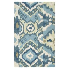 Hand-hooked rug with a teal tribal-inspired motif.   Product: RugConstruction Material: Polyester Color...