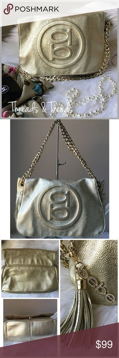 """Authentic BeBe Purse Authentic BeBe purse featuring gold hard ware. Gold chain strap with a drop of 10 inches. Can tuck chain strap away in the purse to be used as a clutch for going out at night. Removable tassel & Bebe logo key chain. 1 zipper pocket on the inside & two open pockets. Bottom measurements are 10"""" by 4.5"""" very very roomy. can fit wallet, phone, keys & other miscellaneous items inside. Retails for 200$. Brand new with tag. Depth is 7.5"""" bebe Bags Totes"""