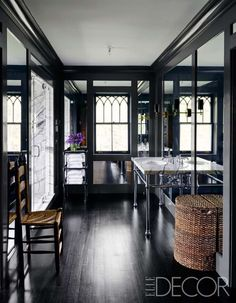 Slide 11 of 21: Black, with hints of white, lend luxury to the master bath of this home in Tuxedo Park, New York. An 18th-century ladder-back chair and a 1920s towel stand in the room, the sink fittings are by Kallista, and the hamper is from HomeGoods.