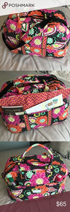 Vera Bradley Large Duffel Bag Used once. Beautiful and big duffel bag. Has 4 big pockets on interior and two beneath flap on front and two small ones on back that are on each side of a flap designed for a luggage handle to fit through. Adjustable strap and two handles. Smoke free and pet friendly home. Vera Bradley Bags Travel Bags