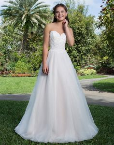 Lightweight organza ball gown featuring a sweetheart lace bodice with natural waistline and chapel length train perfect for the sweet bride.