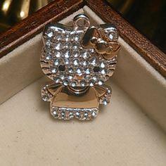 f16f72205 *Rare*Hello Kitty gold toned diamond pendant Adorable Hello Kitty pendant.  Gold and diamonds(cz) make her sooo shiny!!! Very hard to find! Sanrio  Jewelry