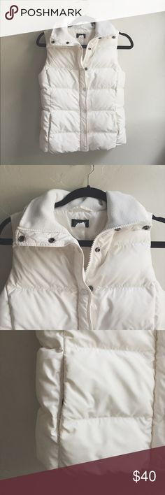 J Crew white puffer vest White J Crew puffer vest. Super cute and very warm. Perfect with a sweater! Big enough to fit a couple of layers underneath. Excellent condition, one tiny pull in the fabric, see last pic. It's hardly noticeable. Note that this does not have a hood J. Crew Jackets & Coats Vests