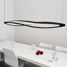 """In the Wind LED Suspension Light.  72""""L x 10.24""""W.   Matt black.  Diffuser in opal metacrylate.  LED.  Line voltage."""