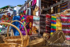 SPAIN. Baskets, rugs and other crafts for sale at a market in Alpujarra de la Sierra (Almeria, Andalucia, Spain).