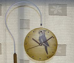 Stand clock Inlay of a parakeet Close up of the front face