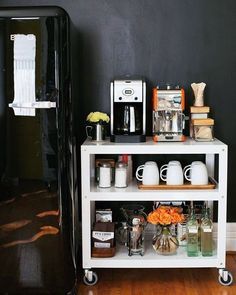 Wake Up to a Well-Styled Coffee Station - YES. THANK YOU, APARTMENT THERAPY. You have solved my coffee and microwave issues with this incredibly obvious solution! Coffee Bar Home, My Coffee, Coffe Bar, Bookshelf Styling, Bookshelves, Coffee Carts, 233, Storage Sets, Cozy Place