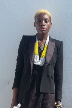 Splash of yellow in an all black outfit.