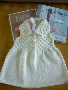 Hand knit baby dress, pure organic cotton. (age 6-9months) approx. www.facebook/Buttonmoon