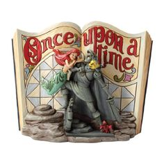 Enesco Disney Traditions by Jim Shore Little Mermaid Storybook Figurine, 6-Inch Enesco,http://www.amazon.com/dp/B00AQ048SY/ref=cm_sw_r_pi_dp_YKh1sb0VQXETSMM8