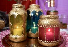 Moroccan Jars. Were used to carry many many things over Millennia  such as Frankenscents & Mirth.  Here use as votive holders, so pretty...