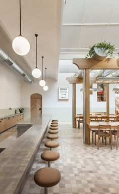From the street, Adelaide restaurant Osteria Oggi looks small; the kind of place you might take an aperitivo. But step inside and the long concrete bar beckons you onward until you spill into a generous naturally lit Tuscan piazza topped with a verdant.