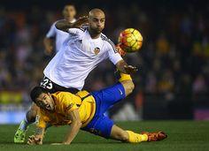 Aymen Abdennour (23) of Valencia battles for the ball with Luis Suarez of Barcelona during the La Liga match between Valencia CF and FC Barcelona at Estadi de Mestalla on December 05, 2015 in Valencia, Spain.