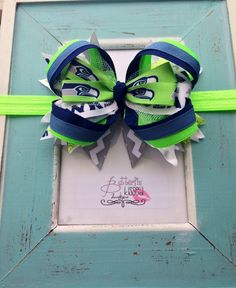 This adorable NFL Seahawks bow is the PERFECT accessory to any game day outfit, blue Friday or ANY DAY you just want to show Seahawks pride!!  A crocheted headband can be purchased separate.  hair bow, bow, hairbow ,seattle seahawks, nfl, football, lime green, green, navy blue.