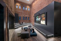 A Tour of Unity's Industrial-Style Headquarters in San Francisco Tiered Seating, Interior Architecture, Interior Design, Cool Cafe, Cool Apartments, Home Studio, Atrium, Small Rooms, Design Firms