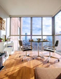 Amazing mid-century apartment located near the St. Lawrence market, in Toronto, Canada. The floor-to-ceiling windows provide panoramic views of the downtown skyline.