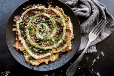A savory pancake that gets stuffed with meat and shredded cabbage. Then it's slathered in tangy BBQ sauce, mayo, powdered seaweed, and bonito flakes.